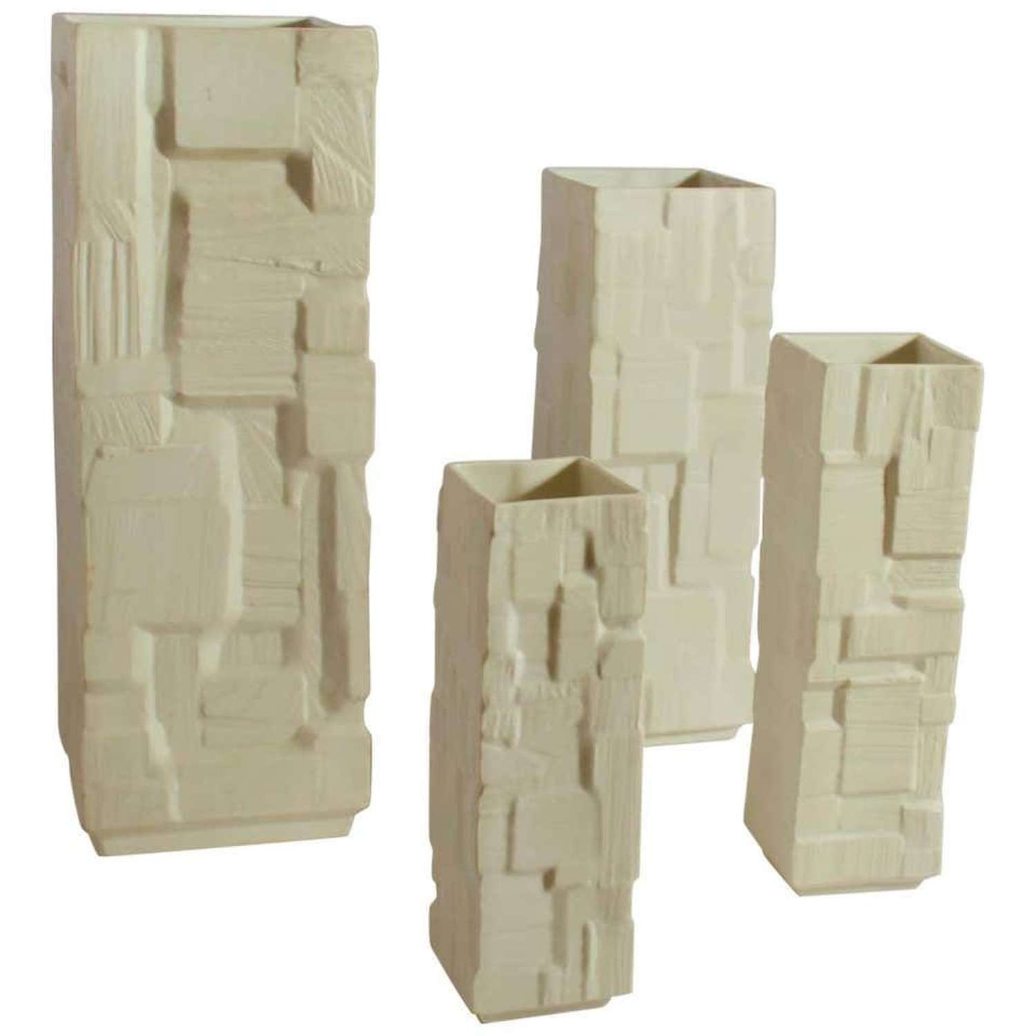 Set of Four White Square architectural Relief Vases